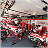 The team work on the Ducati bikes before Race 2 while Michel and Nori go over race tactics.