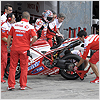 The team work on Nori's bike ready for the next race.