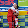 Haga celebrates his second race victory of the season on the podium, where he was congratulated by team manager Ernesto Marinelli.