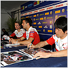 Noriyuki Haga and Michel Fabrizio sign some posters before race at Phillip Island