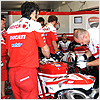 The Ducati Team make improvements to Haga's bike ready for Race 2