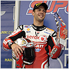 Fabrizio celebrates on the podium at Phillip Island