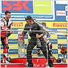 Leon Haslam's race engineer gets sprayed as Michel Fabrizio and Nori Haga celebrate their podium finishes.