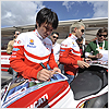 And also take time to sign some posters for the Ducati fans.