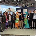 Abdullah al Moallem (center), owner of Khaleej Afaan Printing Press based in Saudi Arabia, purchased a Xerox iGen4 Press. To the right of the Cirque du Soleil animator in blue is Marcus Childs, vice president and general ,manager, Xerox Middle East and Africa.